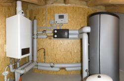 Alternative & Erneuerbare Energien News: Foto: Effiziente Brennwertgeräteauslastung (Lastabfuhr) durch Einsatz eines Pufferspeichers ohne Trinkwas-sererwärmung im Dachgeschoss eines Bürogebäudes.