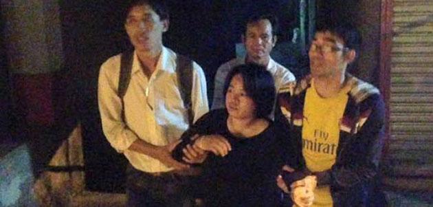 Asien News & Asien Infos & Asien Tipps @ Asien-123.de | Nach der Freilassung aus dem Polizeirevier konnte die Aktivistin Do Thi Minh Hanh kaum gehen und musste von Freunden gestützt werden