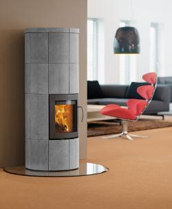 Fertighaus, Plusenergiehaus @ Hausbau-Seite.de | Foto: Der Lotus M2 Speicherkaminofen 2 x heizen bis zu 16 Stunden Wärme.
